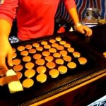 Skilled Japanese Chef Cooks and Flips a Large Batch of Miniature Pancakes With Extreme Speed and Precision