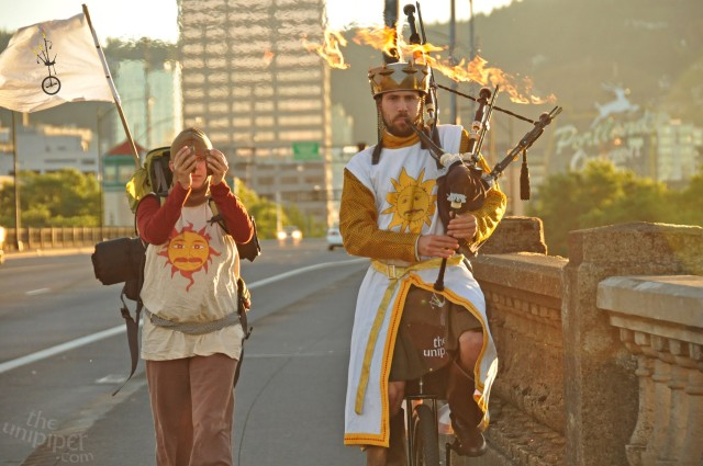 Unicycling King Arthur Performs the 'Monty Python and the Holy Grail' Theme on Flaming Bagpipes