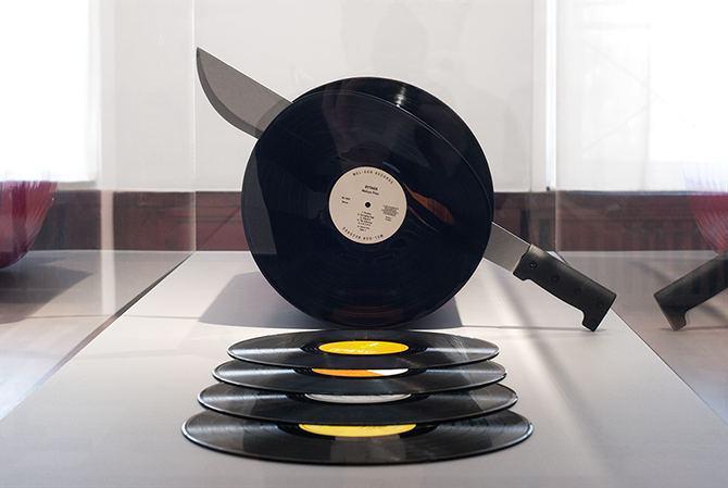 A Punny Sculpture of Records Being Sliced off a Vinyl Sausage