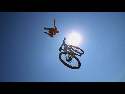 Bicycle Jumping 35 Feet In The Air Into A Pond