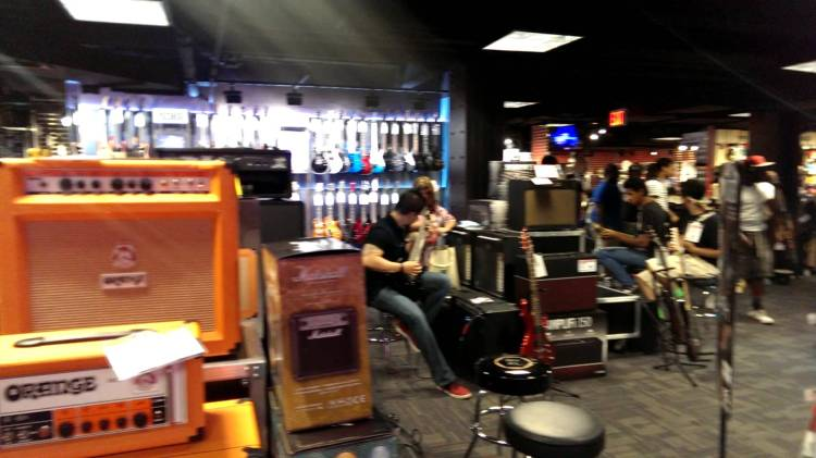 cacophonous video of people trying out instruments at the times square guitar center. Black Bedroom Furniture Sets. Home Design Ideas