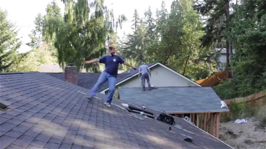Energetic Roofer Can't Help But Dance on the Roof When the Right Song Comes on the Radio