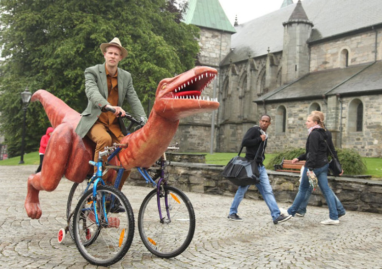 Artist Rides Dinosaur Cycle Across Norway
