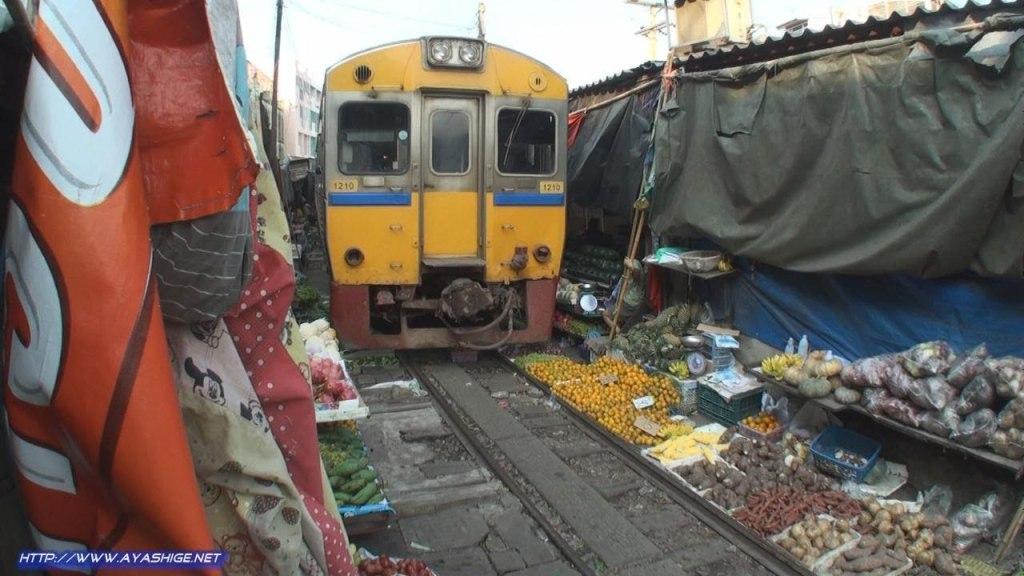 Train Runs Through Middle of Maeklong Market in Bangkok