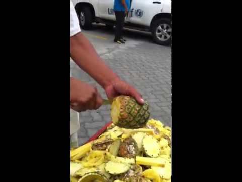 Street Vendor Demonstrates How to Quickly Peel and Slice a Pineapple