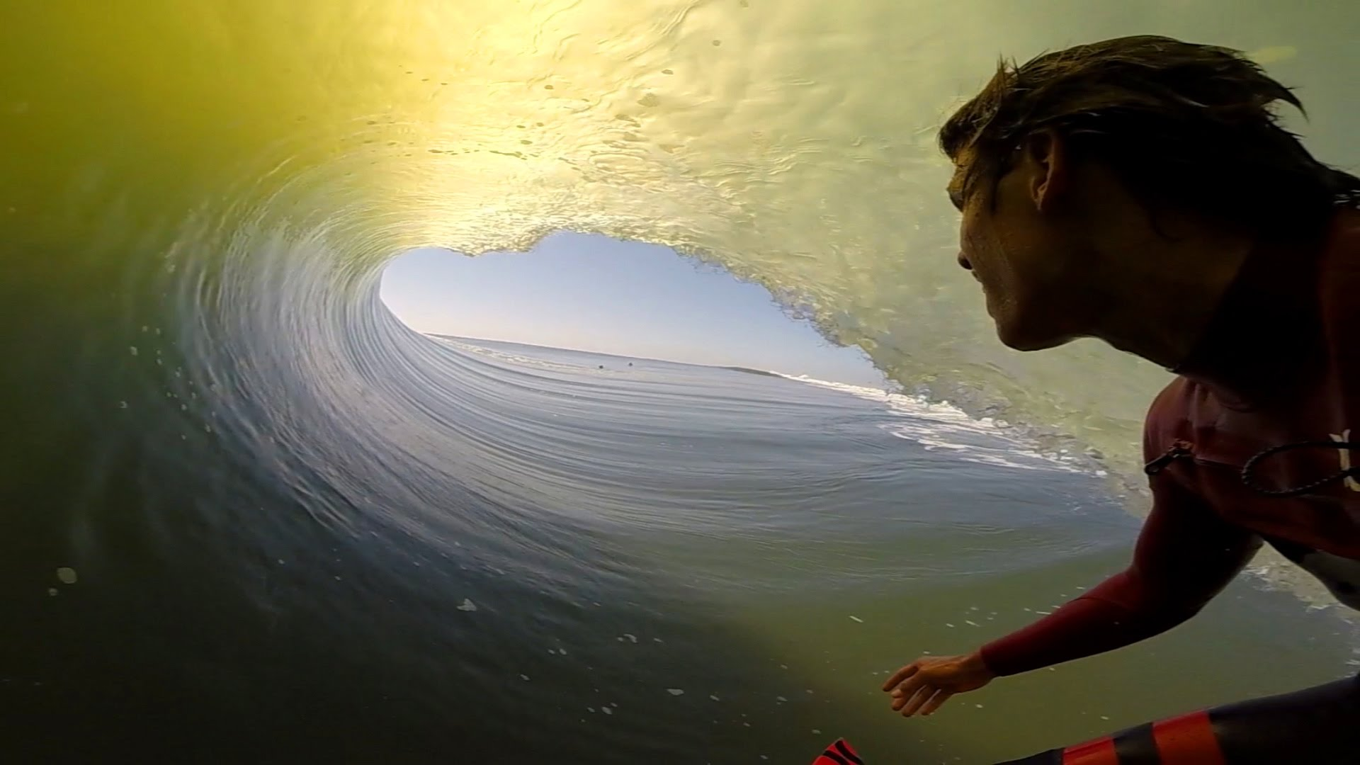 First-Person GoPro Video of a Surfer's Long Ride Inside the Tube of a Wave