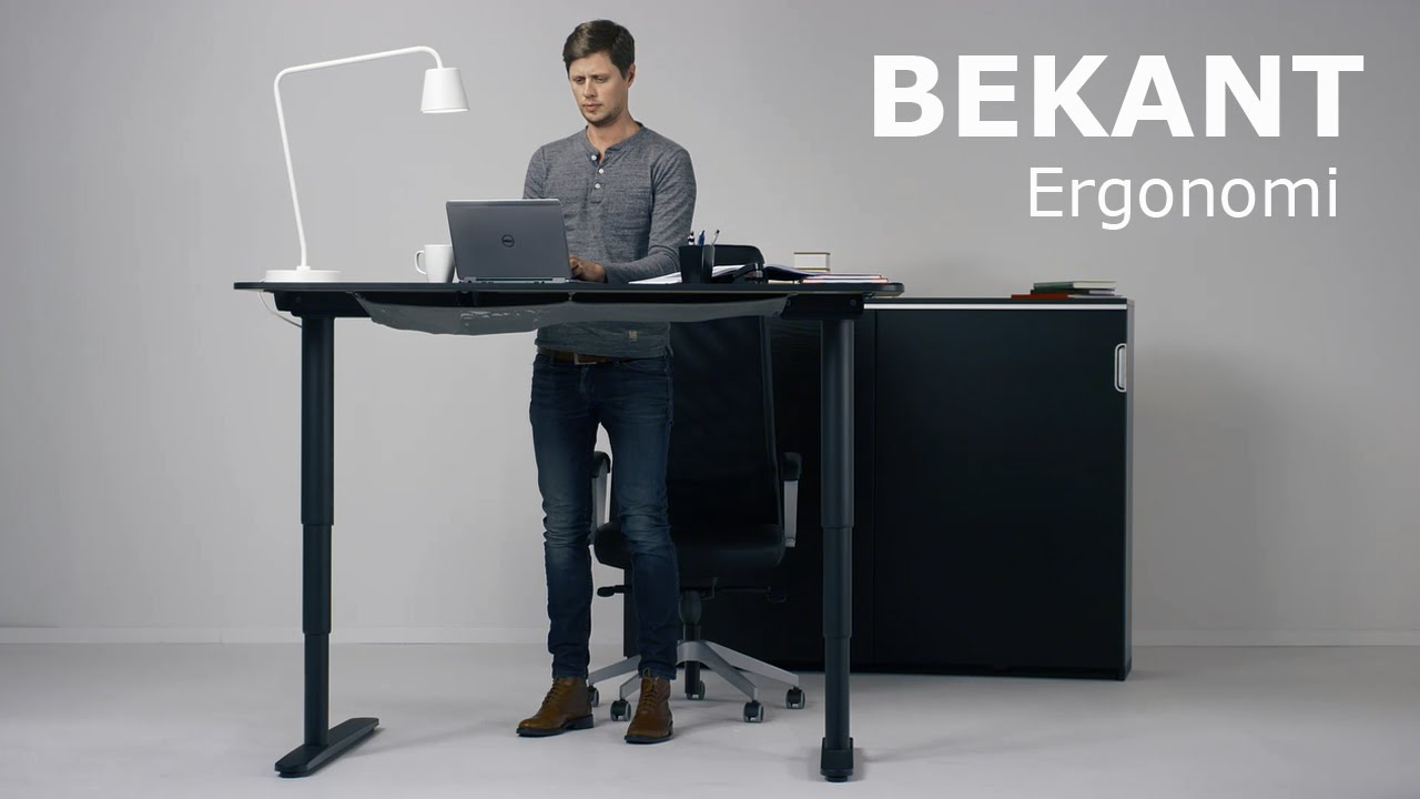 the new ikea bekant sit stand desk can be adjusted with the push of a button. Black Bedroom Furniture Sets. Home Design Ideas