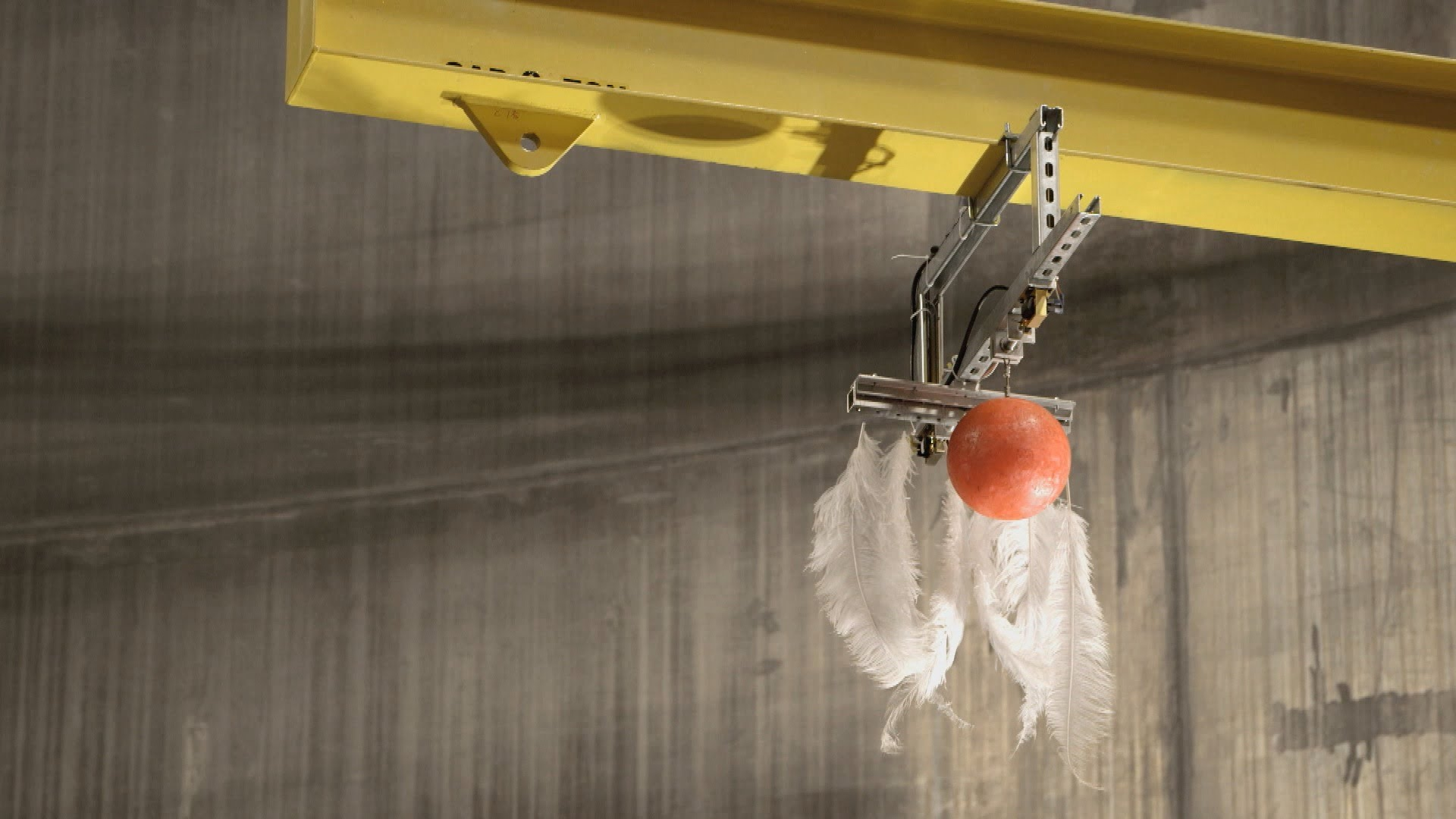 A Feather and a Bowling Ball Dropped at the Same Time Inside the World's Largest Vacuum Chamber