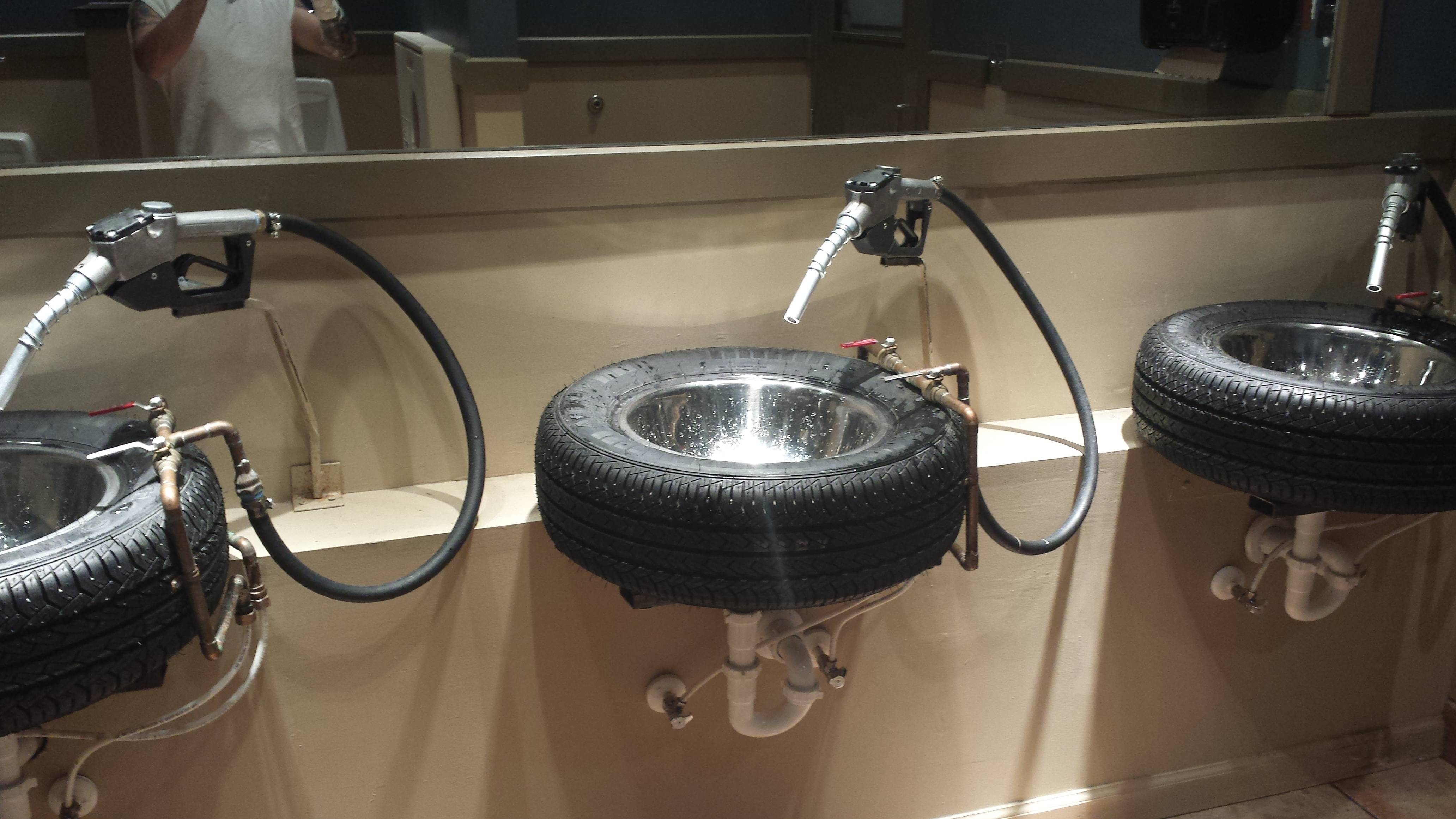 Bathroom sinks from a car themed burger restaurant created