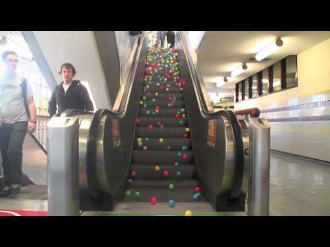 An Experiment Mimicking Perpetual Motion Using an Escalator and a Series of Brightly Colored Balls