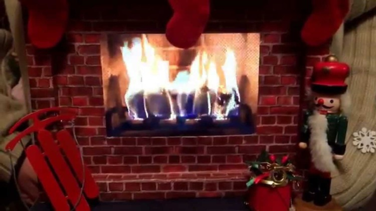 A Prize Winning Ugly Christmas Sweater That Depicts A Full Fireplace Scene Including A