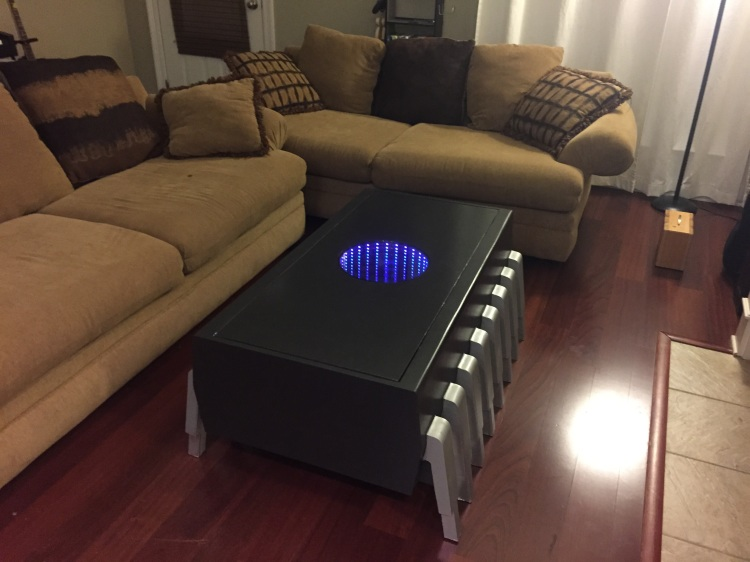 a memory chip coffee table with an illuminated infinity screen