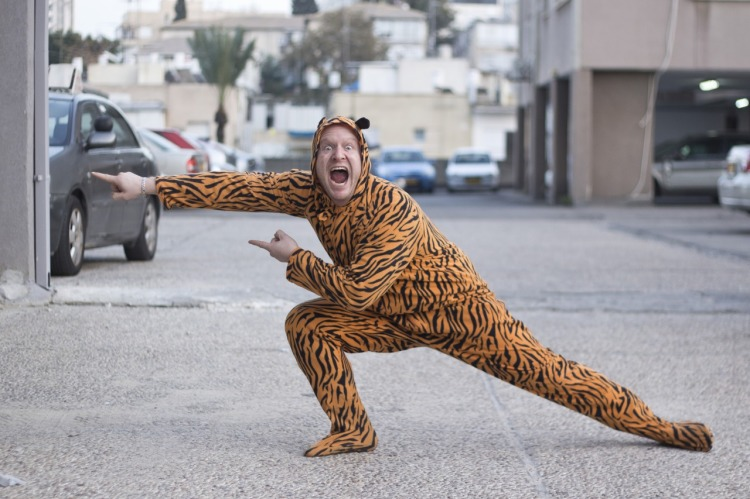 Photographer Convinces Random Strangers to Pose in a Tiger Suit