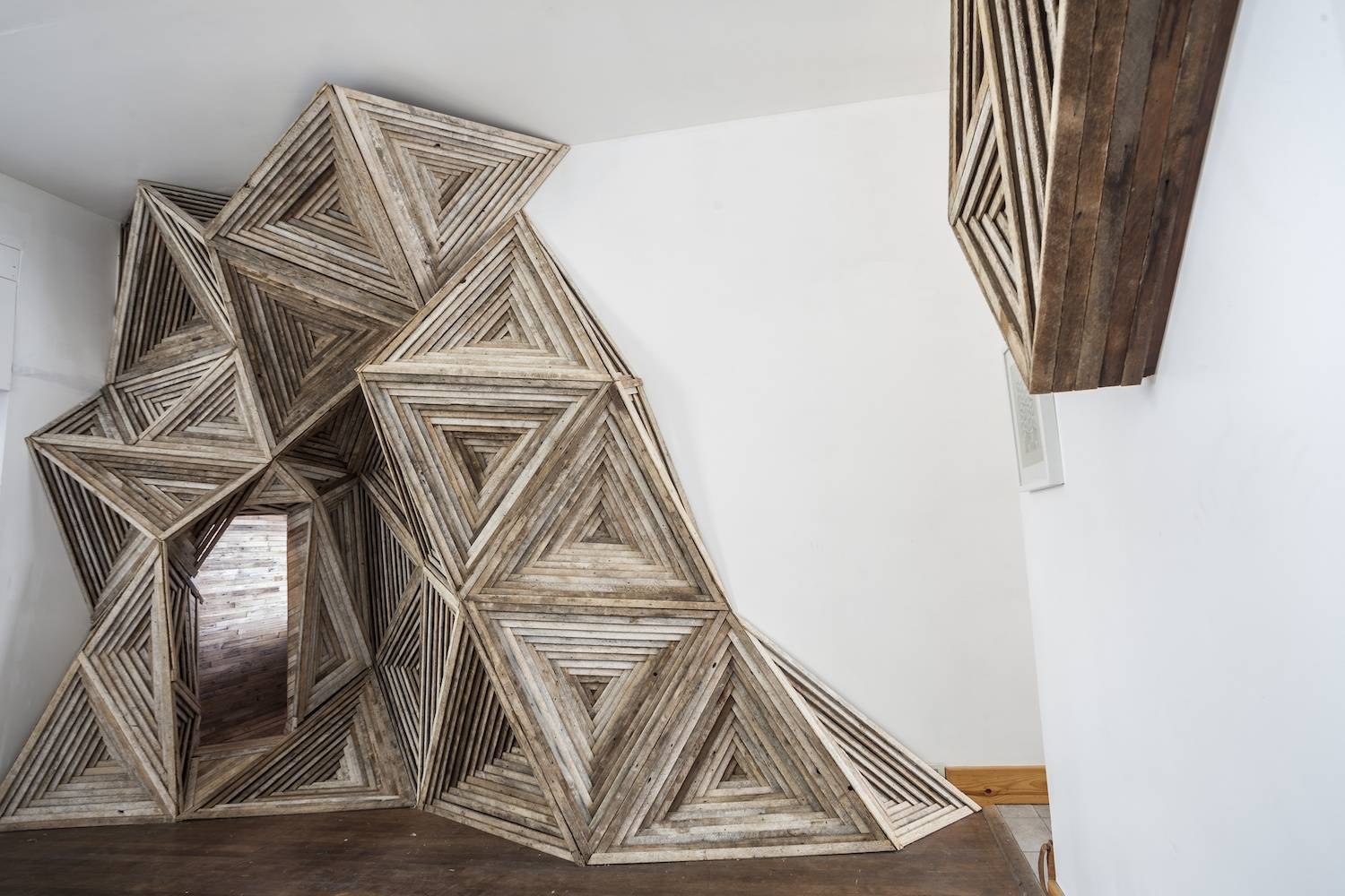 artist transforms salvaged wood into fascinating geometric. Black Bedroom Furniture Sets. Home Design Ideas