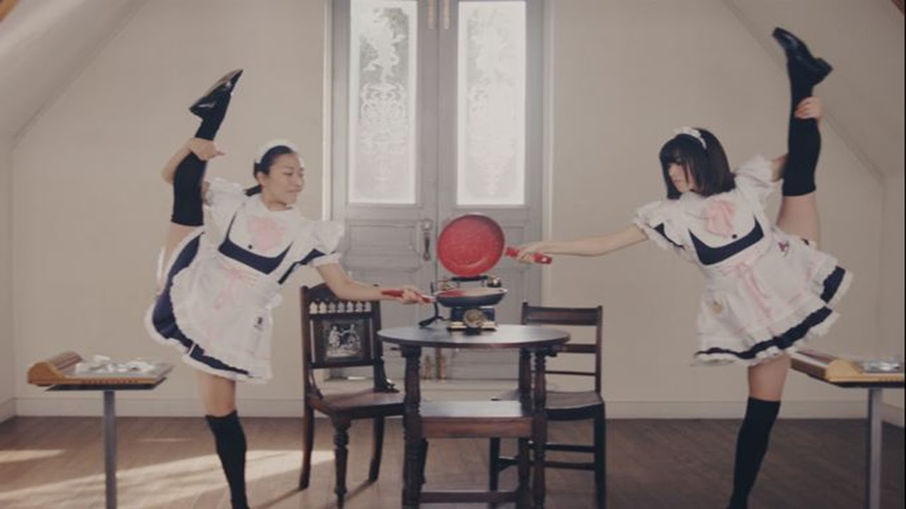 A Bizarre Japanese Commercial Featuring 100 Maids With 100 Frying Pans Elaborately Cooking a Single Pancake