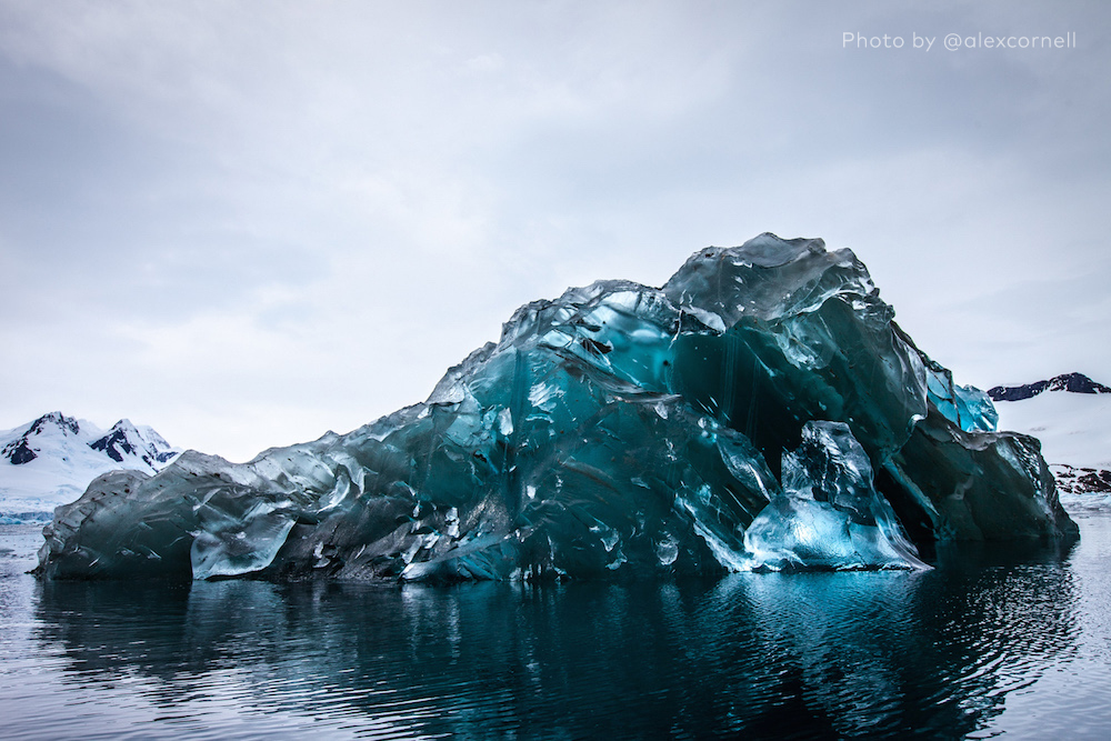 Breathtaking Photos of a Flipped Iceberg That Looks Like a Giant Floating Gem