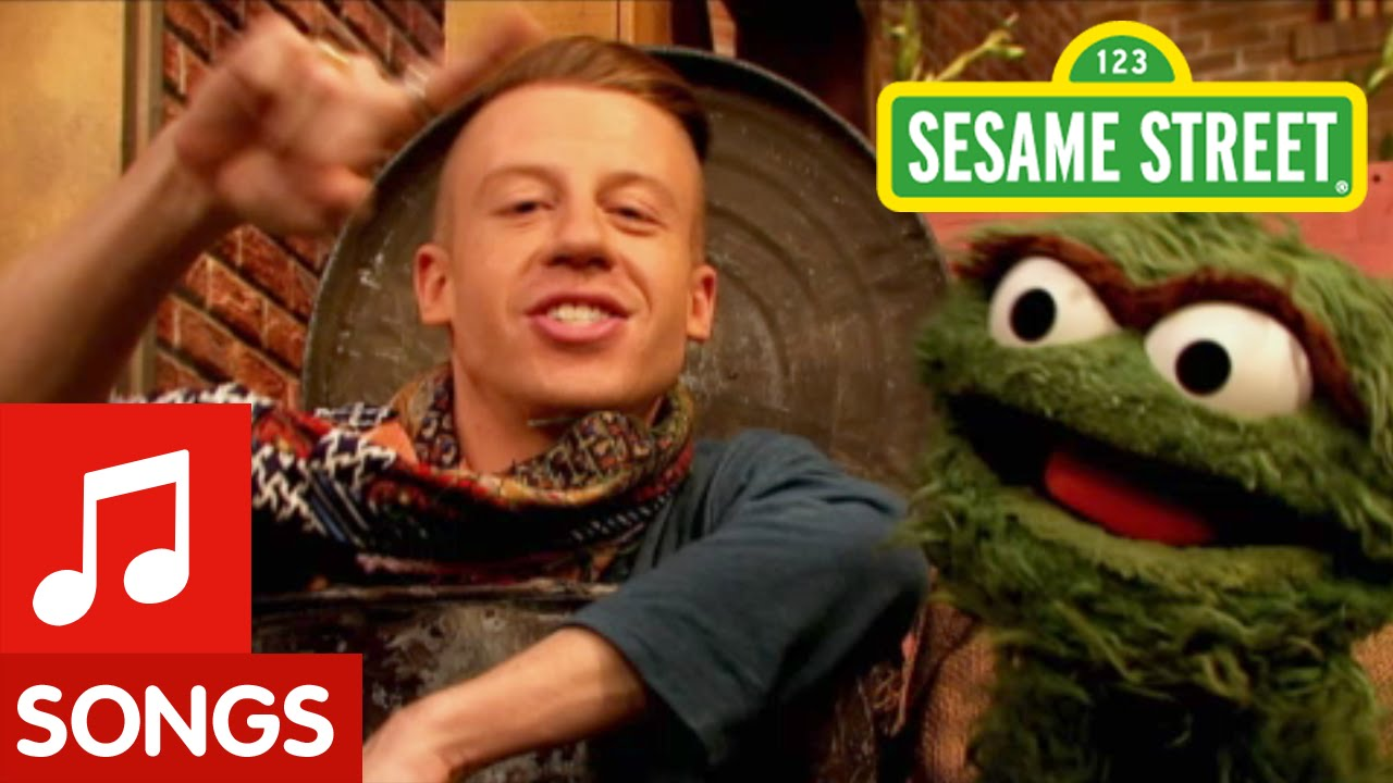 bd52cd6c5269 Macklemore and the  Sesame Street  Grouches Parody  Thrift Shop  to Sing  About Wearing the Stinkiest Garbage Outfits