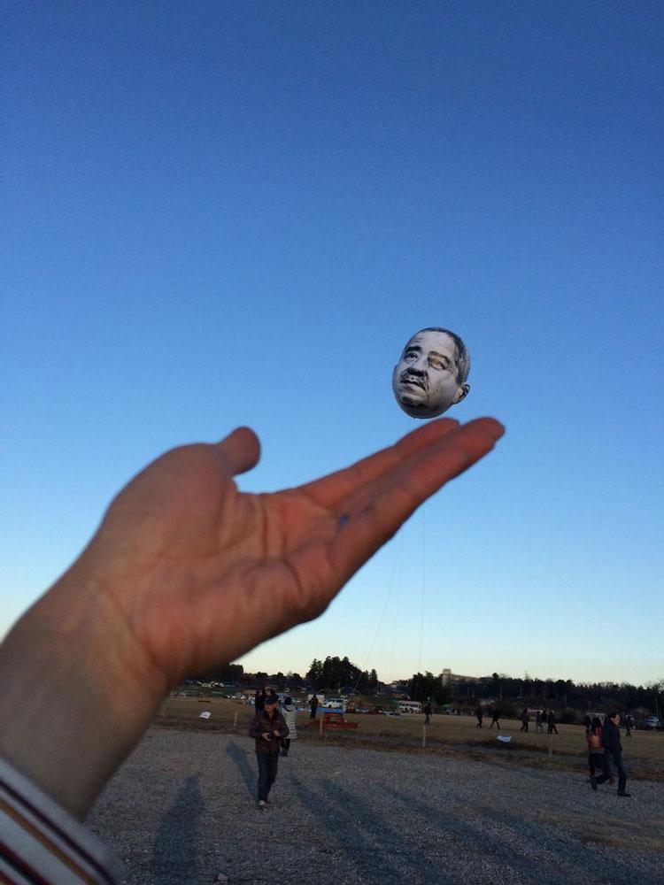 Old Man Balloon Flies Over Japanese City