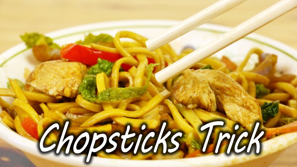 How to Make Using Chopsticks Easier With a Rubber Band and a Strip of Paper