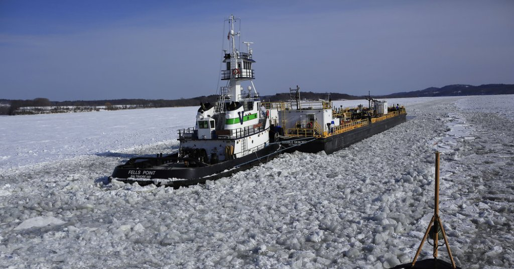 Coast Guard Ship Cuts Through the Icy Hudson River to Provide Safe Water Passage for Boats Carrying Essentials