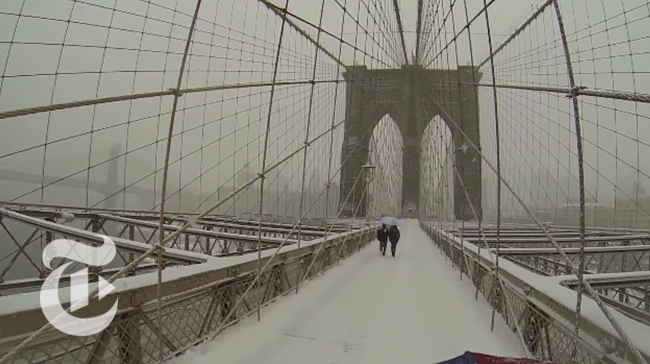 A Camera Mounted to an Umbrella Captures the Experience of Walking Down the Snowy Streets of New York City