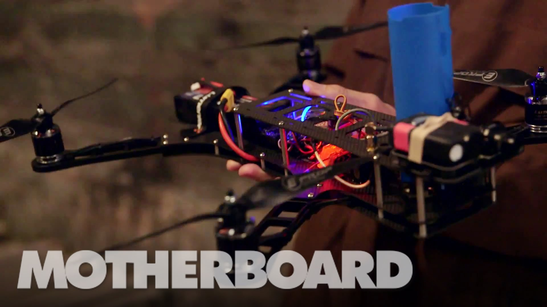 A Drone Mounted With a Nerf Disc Gun Dogfights Inside of an Empty Warehouse