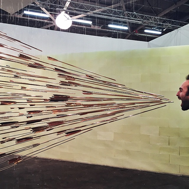 Dozens of Suspended Arrows Converging on One Point