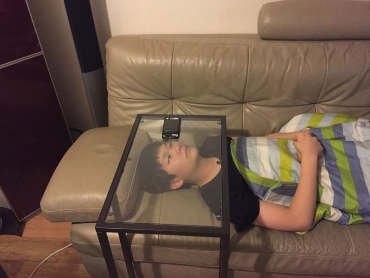 A Resourceful Young Man Uses A Clear Glass IKEA Table As An Improvised  Smartphone Viewer