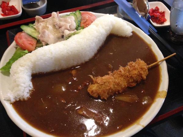 Curved rice dam