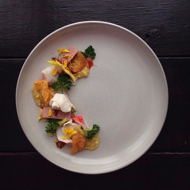 Small portions of junk food artfully plated as gourmet meals for Art de cuisine plates