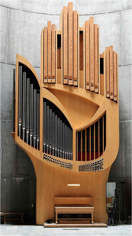 A Sculptural Pipe Organ Shaped Like a Hand in a Modernist French Alpine Church