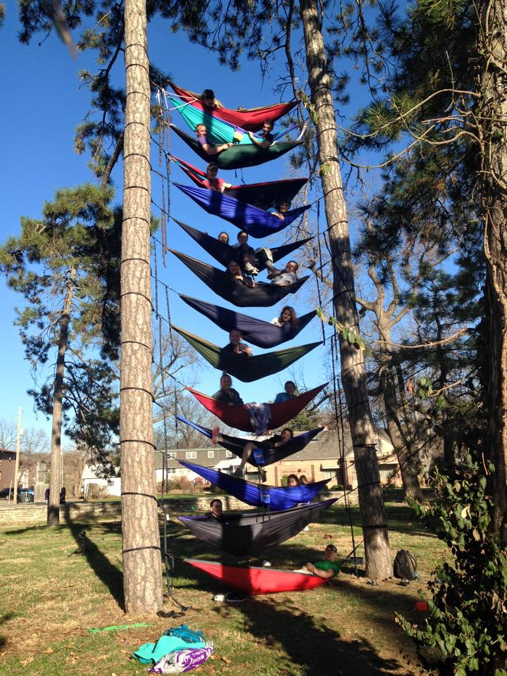 17 People Relax In A Tower Of 14 Hammocks Between Two Trees