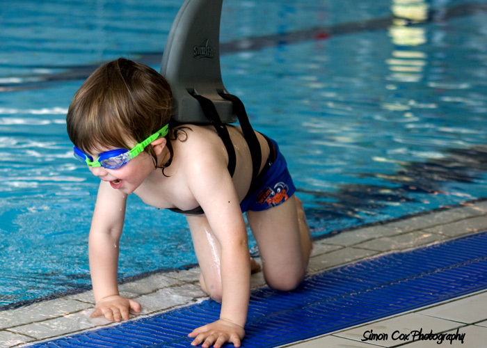 swimfin boy and pool