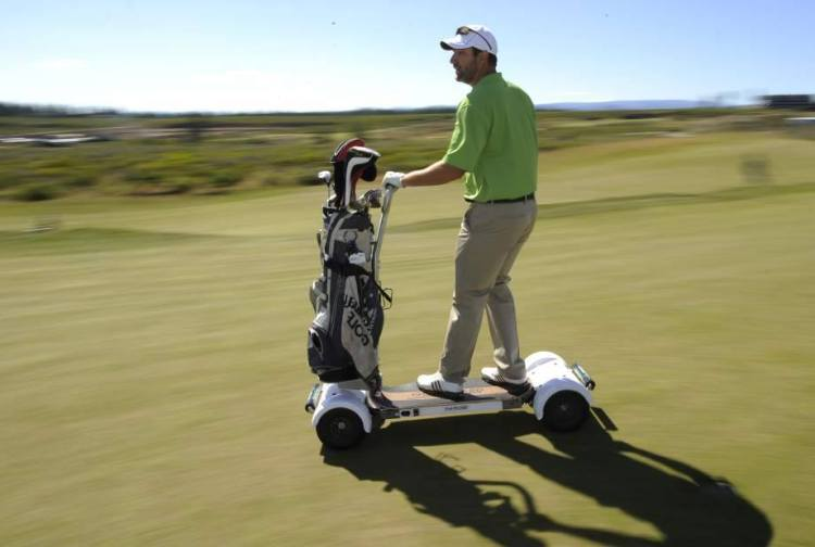 The Golfboard A Standing Golf Cart That You Ride Like A
