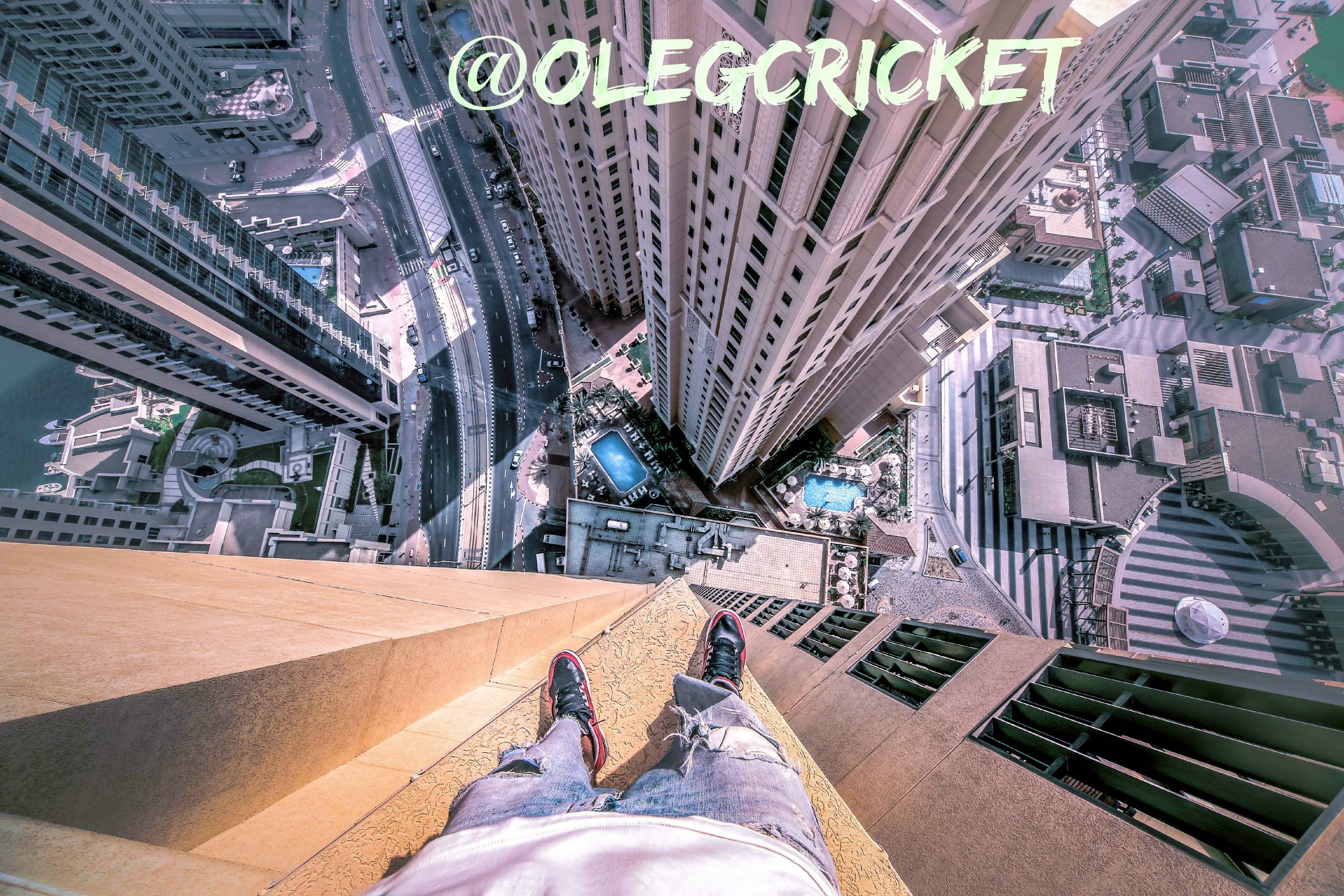 Parkour Traceur Oleg Cricket Makes An Insane Series Of Jumps From Ledge To High On A Skyscraper