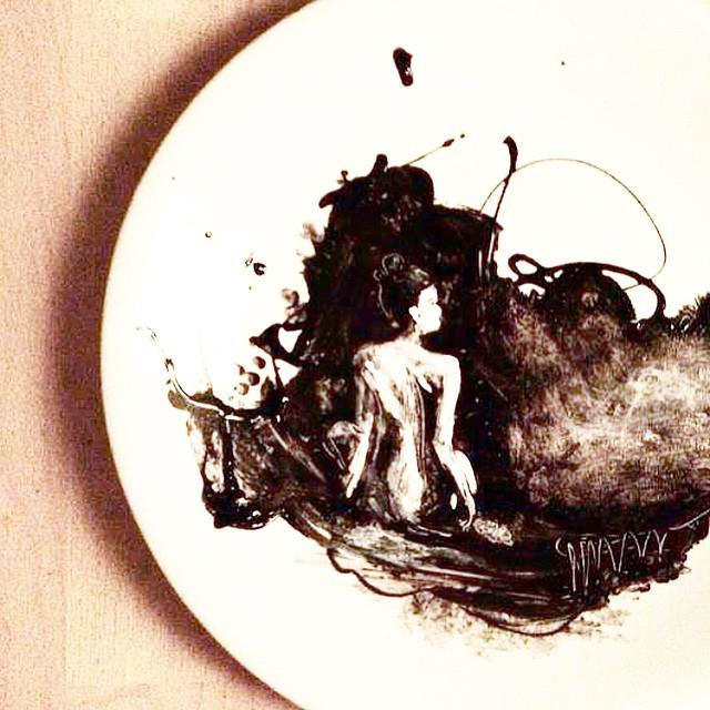 woman painted on plate