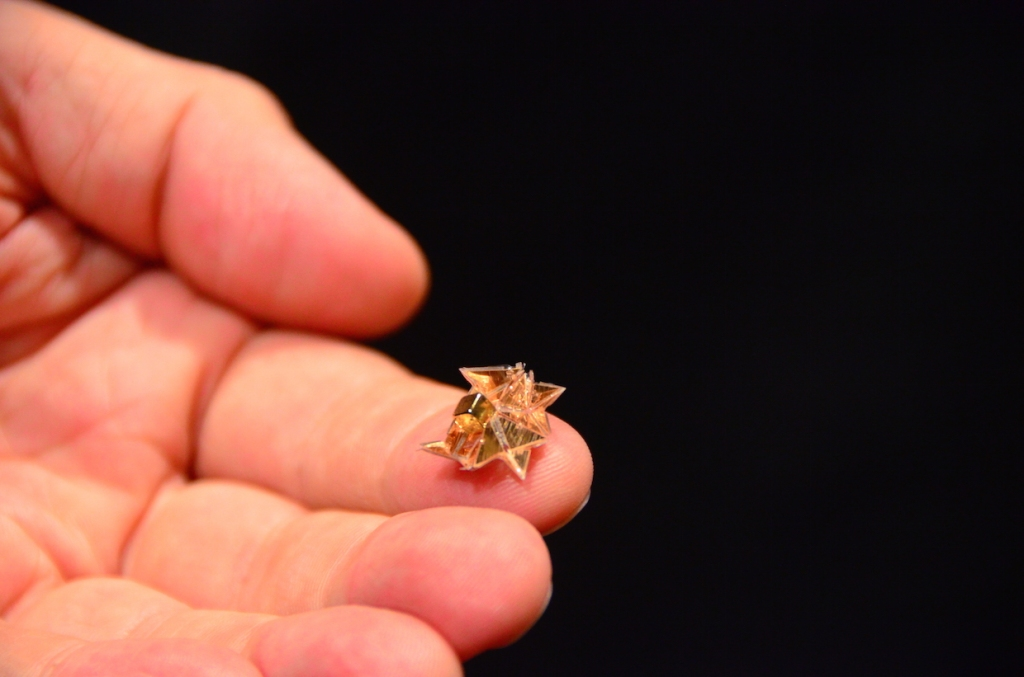 A Dissolvable Miniature Origami Robot That Folds Itself, Walks, Swims, Carries, Digs, and Climbs