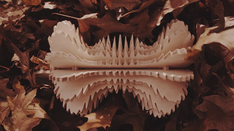 Spinning Daggers sculpture in leaves