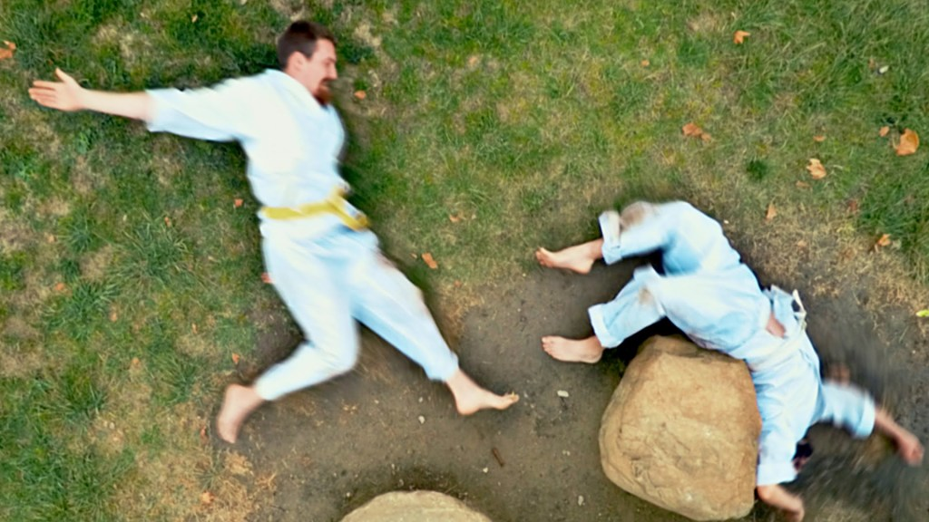 Two Men Fight Over a Lady by Lying on the Ground and Engaging in a Brutal Stop-Motion Animated Karate Battle