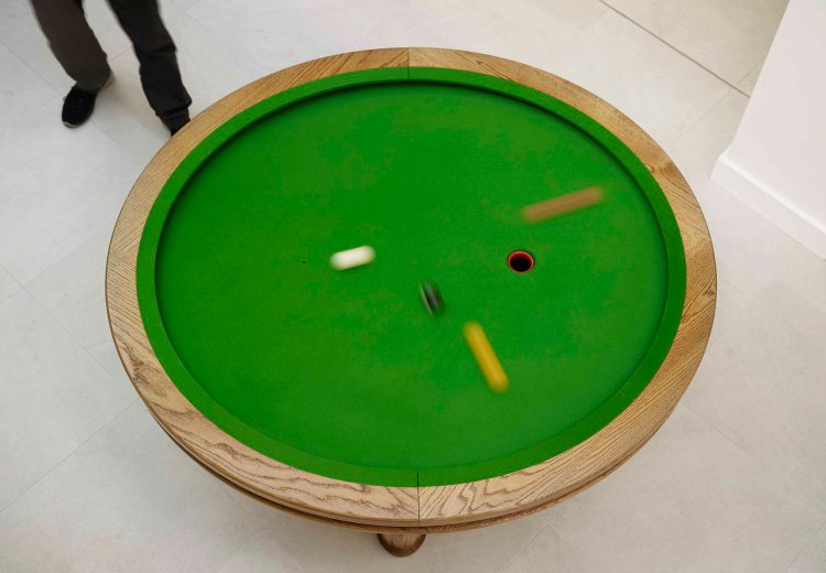 A Unique Elliptical Pool Table and 'Loop' Game Designed by a Mathematician