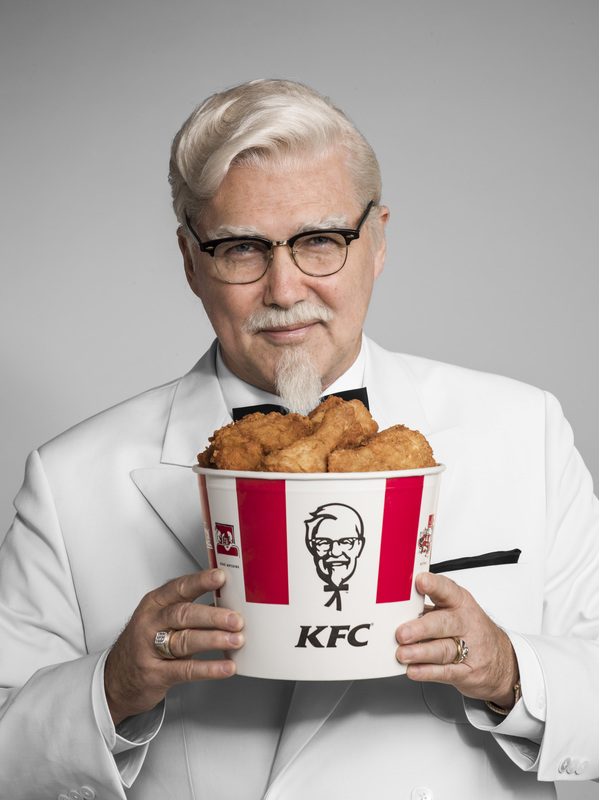 Norm MacDonald Colonel Sanders with a bucket of chicken