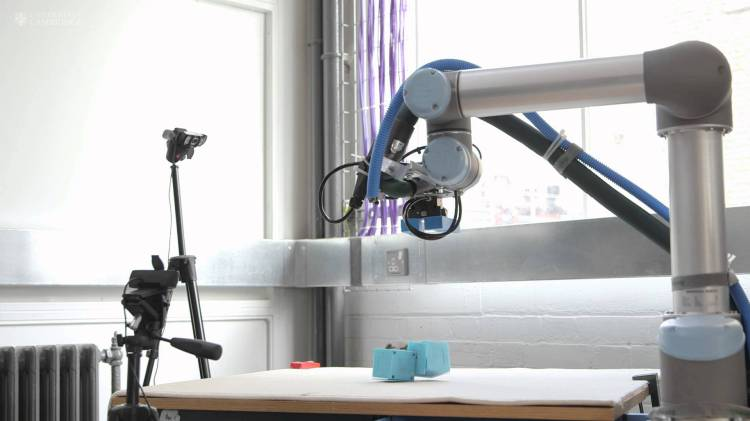 A Robotic 'Mother' Builds Its Own Robot Children From Motorized Blocks and Assesses Which Is Best