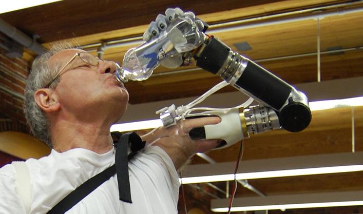 DEKA Arm drinks bottle of water