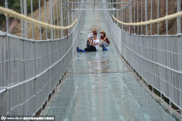 Tourist Selfie on Glass Suspension Bridge