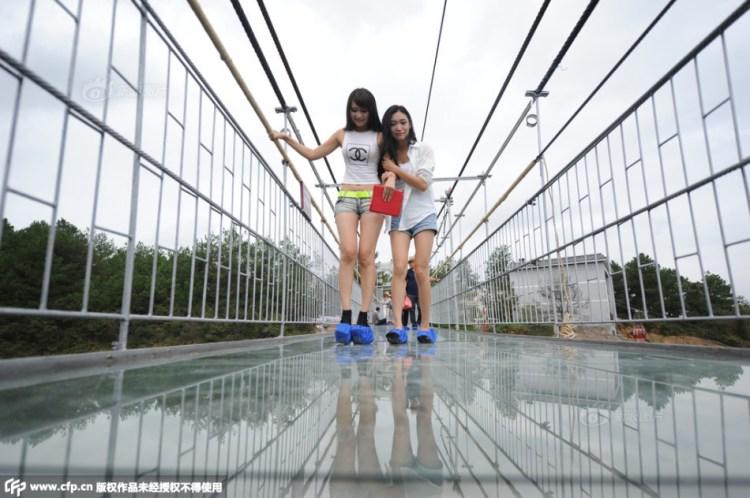 Tourists Walking on Glass Suspension Bridge