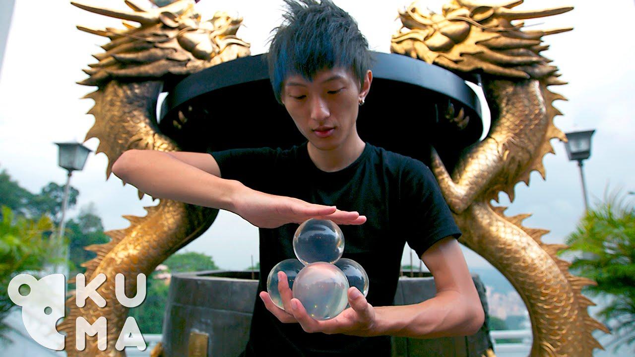 A Contact Juggler Demonstrates His Impressive Skills With Manipulating Acrylic Balls