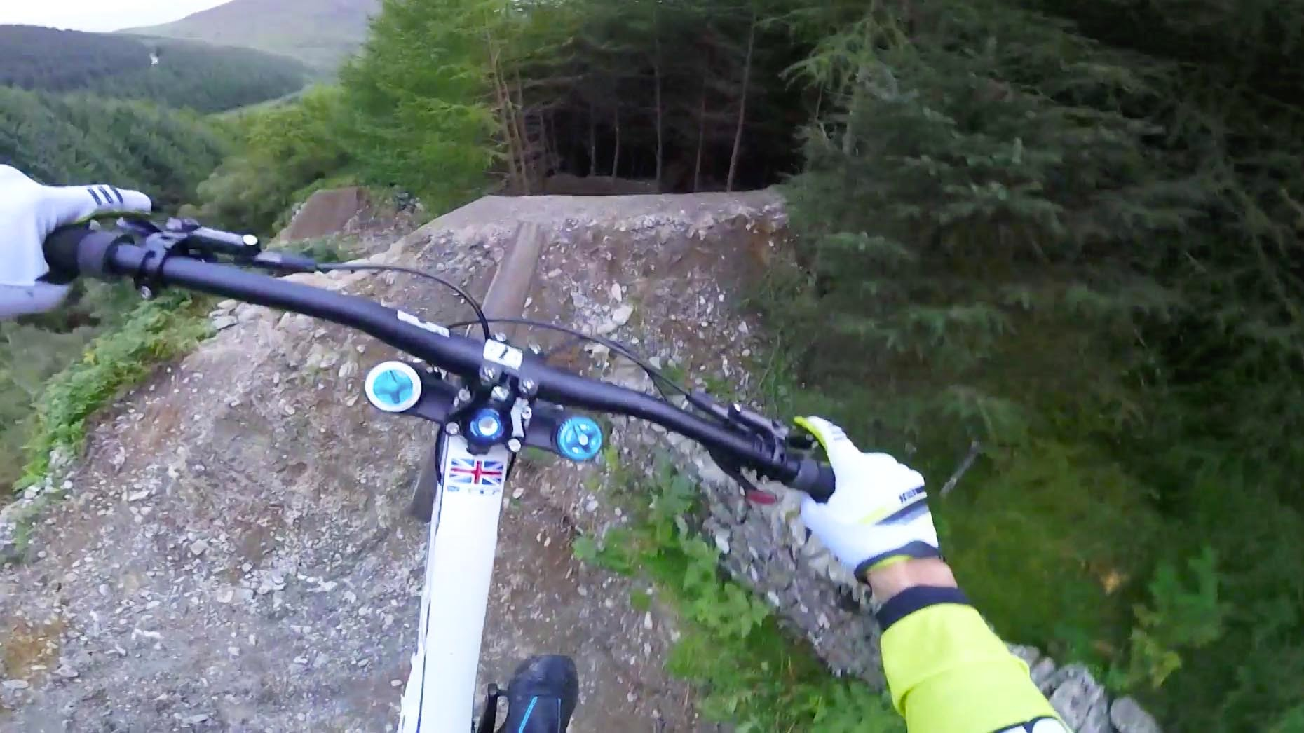 Gee Atherton Speeds Through an Insane Downhill Mountain Biking Trail While Flying Over Road Gaps & Tight Wooded Areas