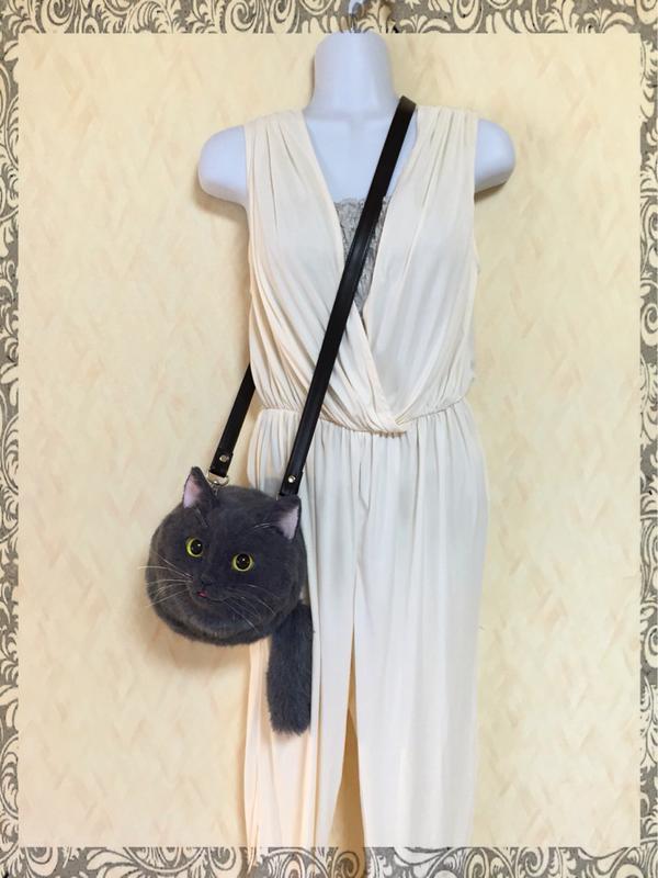 Black Cat Hanging