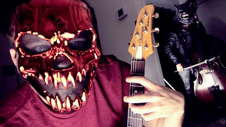 Guitarist Rob Scallon Plays a Spooky Version of the Theme From 'Halloween' While Wearing a Frightening Mask