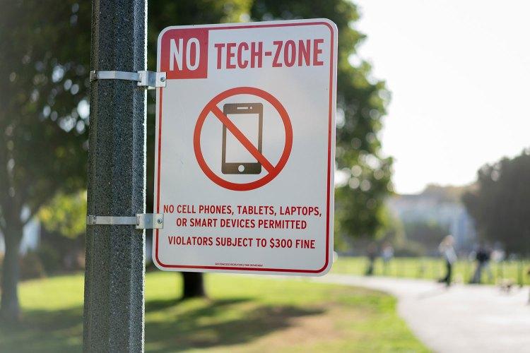 no tech-zone sign on pole